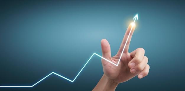 Hand aanraken van grafieken van financiële indicator en boekhoudkundige analyse van de markteconomie