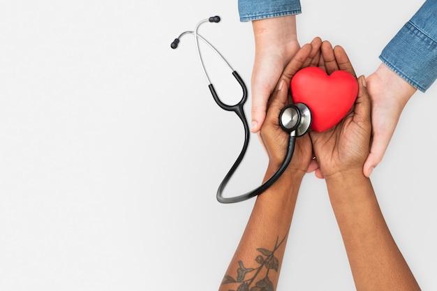 Hand cupping stethoscoop gezondheidsconcept