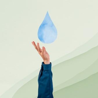 Hand die de remix van de waterbesparingsomgeving voorstelt