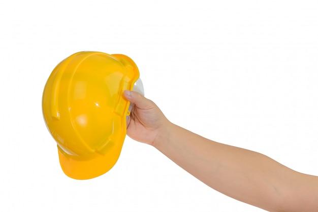 Hand die een bouwvakker, geïsoleerde helm houdt