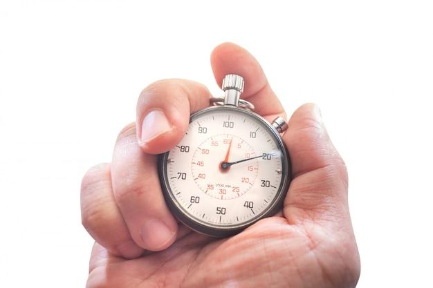 Hand die een chronometer houdt die op wit wordt geïsoleerd