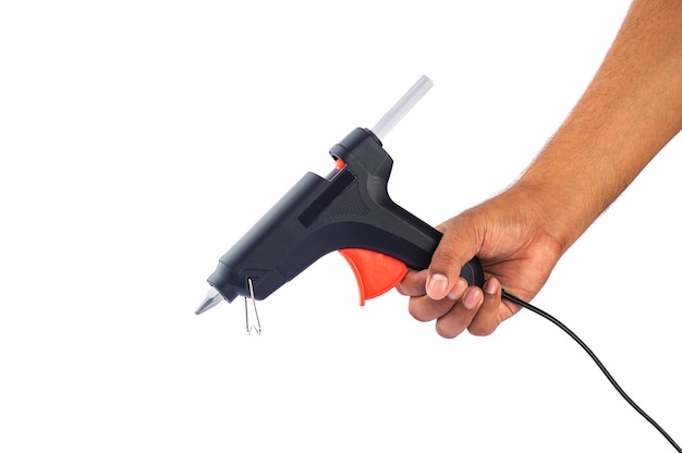 Hand die elektrisch heet lijmpistool houdt