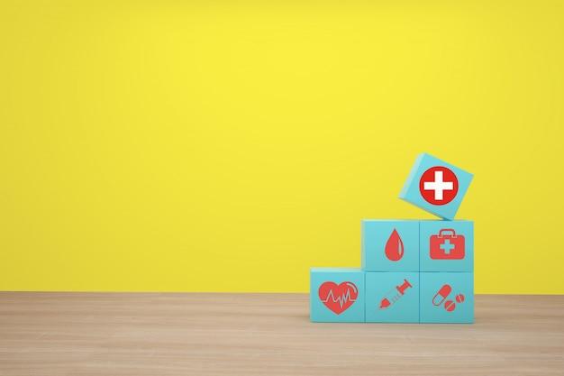 Hand die het blauwe kubusblok stapelen met medische pictogramgezondheidszorg schikken.