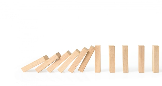 Hand die het domino-effect stopt, gestopt door uniek
