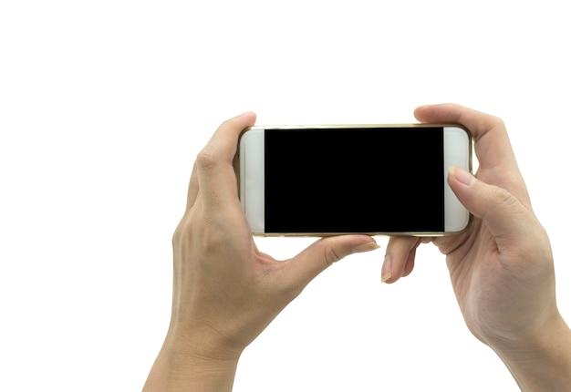 Hand die slimme telefoon houdt die over witte achtergrond wordt geïsoleerd - modelmalplaatje