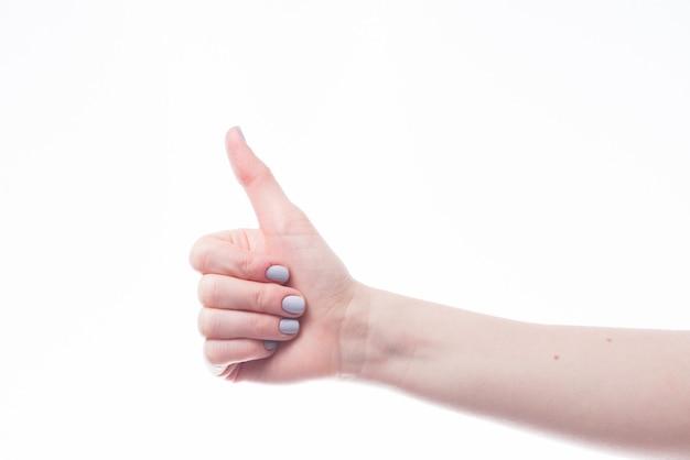 Hand gesturing duim omhoog