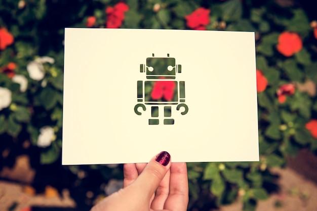 Hand hold robot papier snijwerk met aard achtergrond