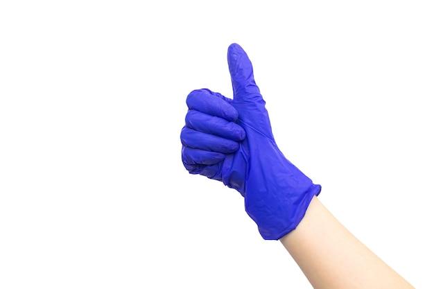 Hand in medische rubberen handschoen duim omhoog ok gebaar, geïsoleerd op een witte achtergrond foto
