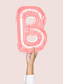 Hand met ballon letter b