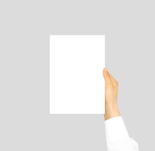 Hand met blanco flyer brochure boekje in de hand