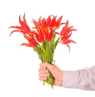 Hand met boeket bloemen
