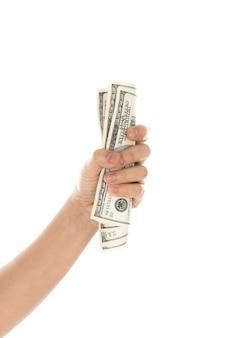 Hand met dollars op een witte achtergrond