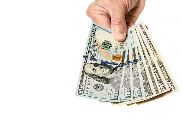Hand met geld dollars, geïsoleerd op wit