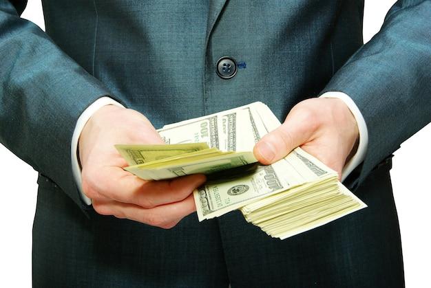 Hand met geld geïsoleerd op een witte achtergrond