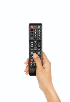 Hand met multimedia-afstandsbediening op witte achtergrond