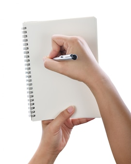 Hand met pen die op notitieboekje schrijft