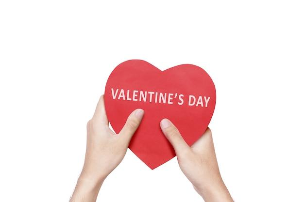 Hand met rood hart met happy valentijnsdag tekst geïsoleerd over witte muur