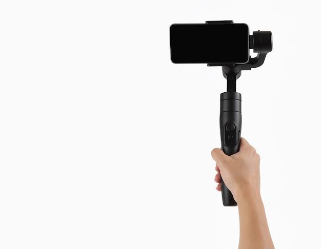 Hand met stabilisator voor mobiele telefoon op witte achtergrond