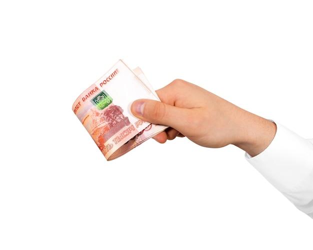 Hand met stapel van russische roebels, geïsoleerd.