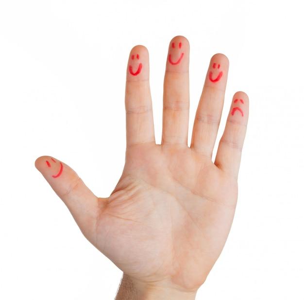 Hand met vingers smileys, behalve één vinger verdrietig.