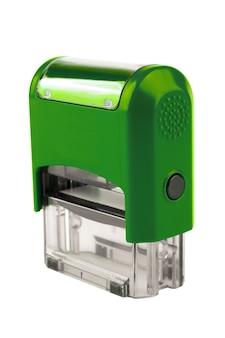 Hand rechthoekige automatische stempel, een schitterende groene kleur. geïsoleerd op witte achtergrond.