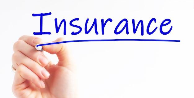 Hand schrijven inscriptie verzekering met blauwe kleur marker, concept, stockafbeelding