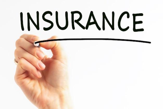 Hand schrijven inscriptie verzekering met marker, stockafbeelding