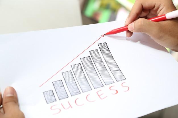 Hand tekenen zakelijk succes grafiek