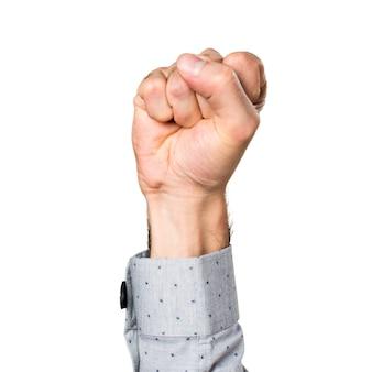 Hand van de mens met zijn gesloten vuist
