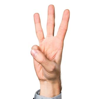 Hand van de mens tellen drie