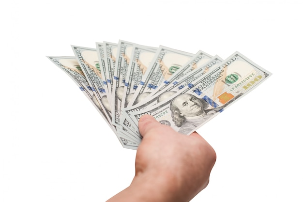 Hand van mensenholding gewaaide vuistige dollarsrekeningen