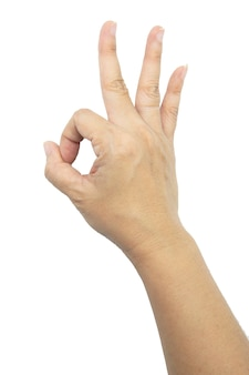 Hand van vrouw die ok geïsoleerd gebaar toont