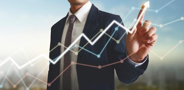 Hand wat betreft grafieken van financiële indicator en boekhoudkundige markteconomie analysegrafiek