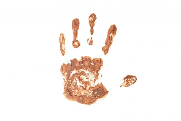 Handafdruk met chocolade die op wit wordt geïsoleerd