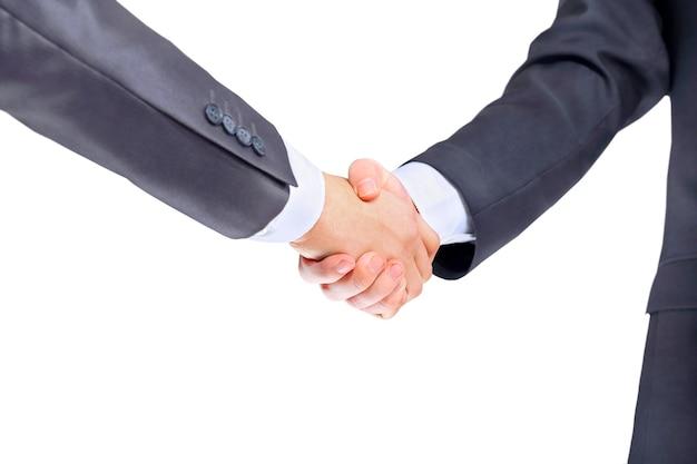 Handdruk van zakenpartners na ondertekening veelbelovend contract