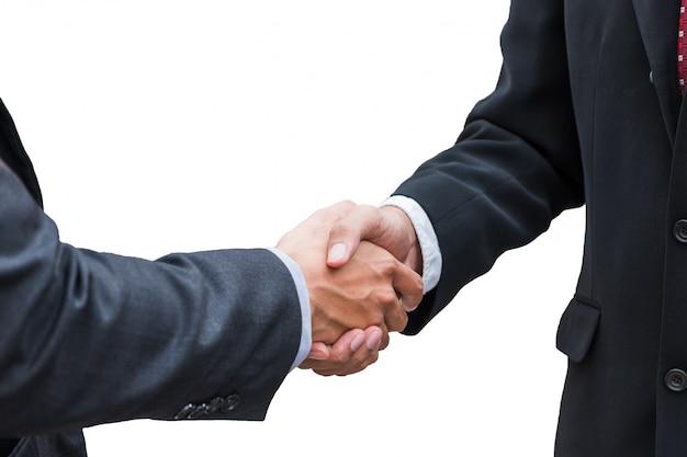 Handdrukovereenkomst van zakenman met vennootschap op achtergrond