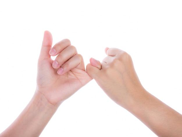 Handen afdichten van een belofte met de kleine vingers