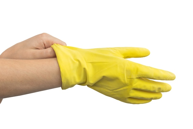 Handen die gele rubberen handschoen dragen, schoonmaakconcept, geïsoleerd op een witte achtergrondfoto