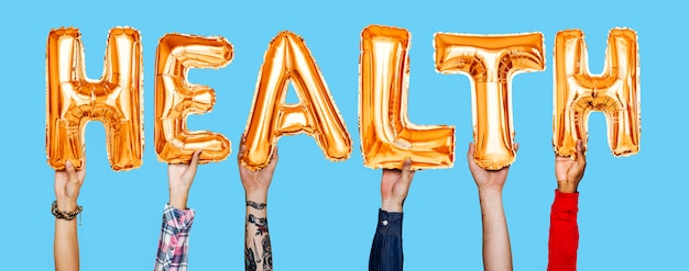 Handen die het woord van gezondheidsballonnen tonen