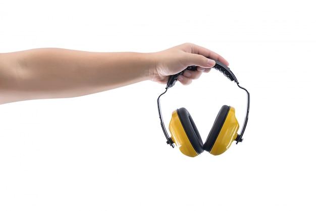 Handen houdt werken beschermende koptelefoon is geïsoleerd