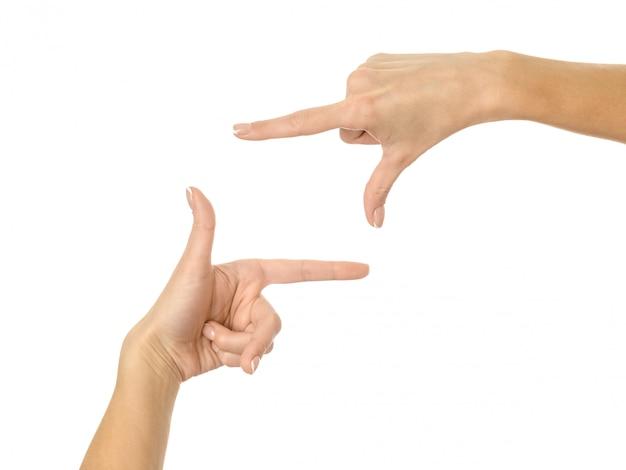 Handen inlijsten. vrouwenhand gesturing geïsoleerd op wit