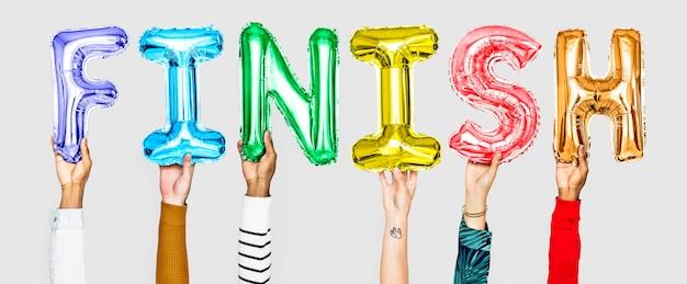 Handen met afwerking woord in ballon letters
