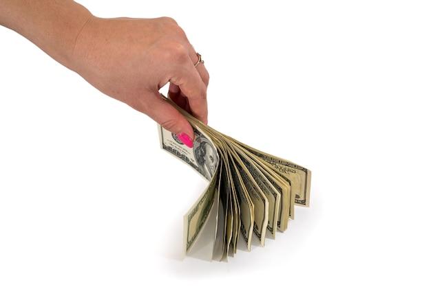 Handen met dollargeld op wit wordt geïsoleerd dat