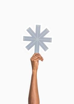 Handen met een asterisk-symbool
