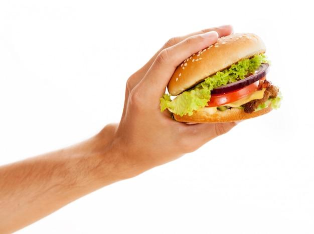 Handen met een hamburger