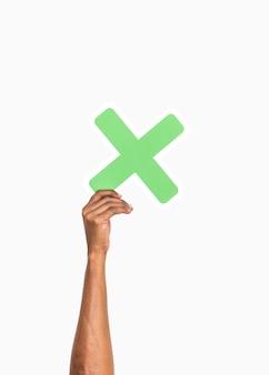 Handen met een vermenigvuldigen symbool