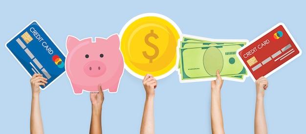 Handen met financiële pictogrammen grafisch