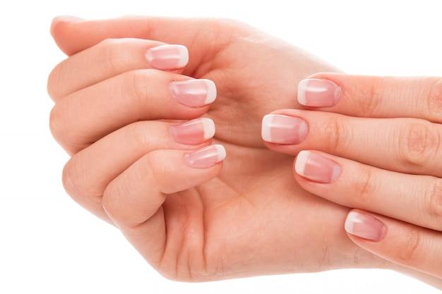 Handen met french manicure
