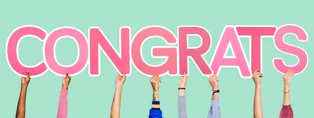 Handen met het woord congrats