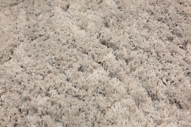 Handgemaakte pluizige tapijt textuur, close-up.
